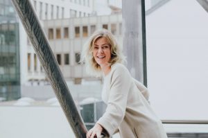 Portrait photo of The Office Luxembourg founder, Gosia Kramer, in an urban setting, in Luxembourg City centre